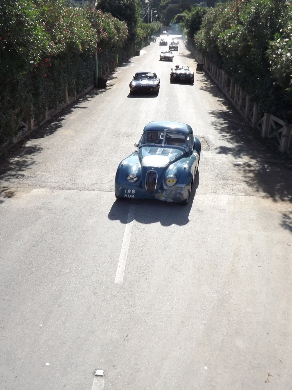 A Jag-fest lead by Guy Broad with a patched up XK, with E and C types chasing