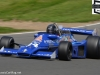 Frank Lyons in a Hesketh 308 at Paddock Hill Bend in the F1 Masters