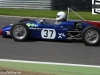 James Owen in a Elva 200 at the top of Paddock Hill Bend in the Larani Trophy
