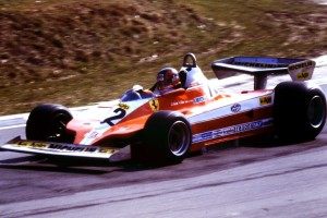 Giles Villeneuve in a SPA Ferrari SEFAC 312 T3 at 1979 F1 on the exit of Druids going down Graham Hill at Brands Hatch