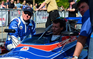 Greg Thornton and Tom Smith ensure Prince Joachim is ready to drive the Chevron B24 F5000