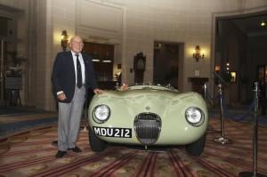 Sir Stirling Moss by his 1952 Reims Grand Prix-winning Jaguar C-type