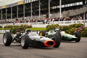 Sir Jackie Stewart's BRM P261 leads Dario Franchitti's Lotus 25, Goodwood lap record demonstration