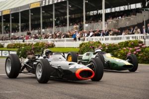 Sir Jackie Stewart's BRM P261 leads Dario Franchitti's Lotus 25, Goodwood lap record demonstration