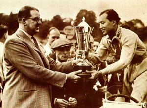 awarded to Bira by Charles Follett with Chula looking on