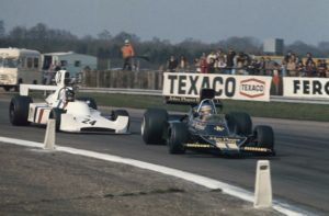 James Hunt winning his maiden F1 race after duelling with Ronnie Peterson's JPS Lotus at Silverstone in 1974 (photo: LAT Photographic)