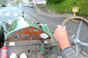 On board in Laon focusing down the long bonnet, ahead a V12 Cadillac from 1933