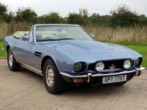 A 1979 Aston Martin V8 Volante in Tourmaline Blue, is estimated to sell for £160000 – 180000. (Lot 92)