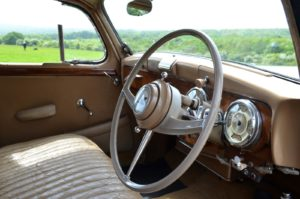 Interior Bakelite, leather, wood and chrome surrounding Jaeger dials a great place to travel