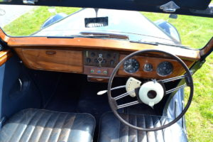 Indicators atop steering wheel and transmission pre-selector on the left the rest is wood and leather