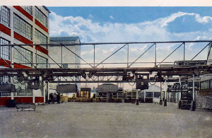 More than a mile and a half of overhead monorail track ran throughout the factory taking parts to the workforce and each electrically powered car was driven by one operator within a cab