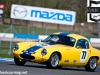 Davison in the Lotus Elite crests Mclean's during qualifying for the Pre-63 GT race.