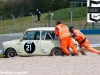Marshalls push the Mini Cooper of Hall/Wakeman out of the gravel trap at McLean's during qualifying.